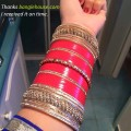 red and gold punjabi chura in hand