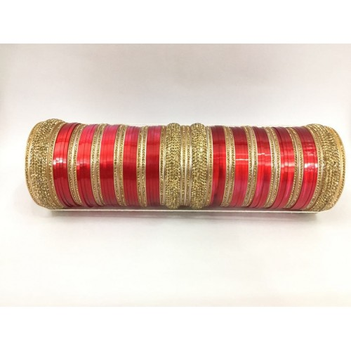 Shiny red bridal chuda with gold stones